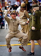 Cornell Iliescu gets down to the sound of big band music with his partner Helen Nielsen at a Veteran's Day celebration at the Orange County Fair and Events Center in California.