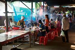 Eating At Long Table At Market