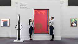 "© Licensed to London News Pictures. 16/11/2018. LONDON, UK. Technicians present ""Rumbold Vertical Two: Reds with Purple and Orange: March 1970"", 1970, by Patrick Heron (Est. GBP120,000-180,000).  Preview of Sotheby's autumn sale of Modern & Post War British art.  Works from the British art scene of the past century will be offered for sale on 20 and 21 November 2018 at Sotheby's in London.  Photo credit: Stephen Chung/LNP"