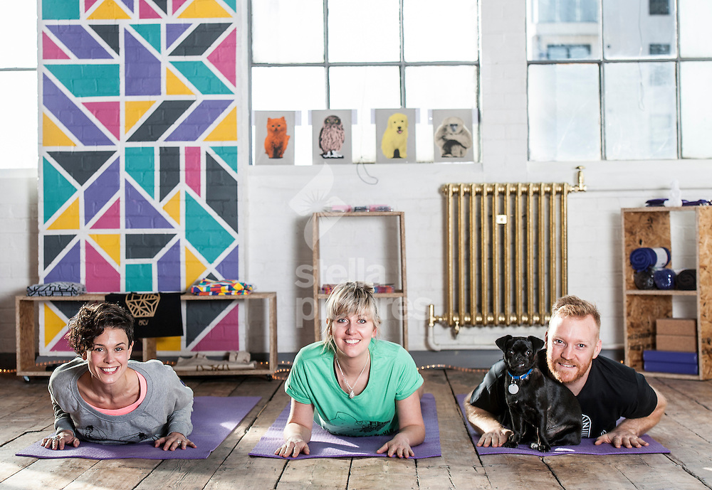 Emma Arnold (left) and Sean Hitzelberger from Yogarise with Evening Standard writer Emily Jupp. <br /> Picture by Daniel Hambury/Stella Pictures Ltd +44 7813 022858<br /> 03/03/2014