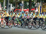 11 DECEMBER 2015 - BANGKOK, THAILAND: His Royal Highness Crown Prince MAHA VAJIRALONGKORN, the heir apparent to the Thai crown, (far left, red bike, short sleeves, blue gloves) leads the Bike For Dad bike ride in Bangkok. More than 527,000 people registered for the Bike for Dad event to honor Bhumibol Adulyadej, the King of Thailand, whose birthday is also celebrated as Father's Day in Thailand. In Bangkok, 99,999 people registered for Bike for Dad. More than 418,000 people registered for Bike for Dad rides in the provinces outside Bangkok and 9,805 participated in Bike for Dad events outside of Thailand. The Bangkok route was 29 kilometers long (18 miles) and traveled through Bangkok and across the Chao Phraya River into Thonburi. Bike for Dad events were held across Thailand.     PHOTO BY JACK KURTZ