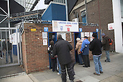 People queue at turnstiles for Greene King Stand for Home supporters, Ipswich Town Football Club, Portman Road, Ipswich, Suffolk, England