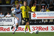 Matty Done takes on a Burton defender during the EFL Sky Bet League 1 match between Burton Albion and Rochdale at the Pirelli Stadium, Burton upon Trent, England on 4 August 2018.