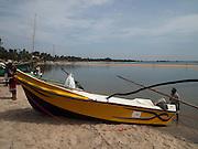 Sri Lanka, Ampara District, Arugam Bay, Pottuvil a small fishing village and popular surfing resort. Fishing boat on the shore