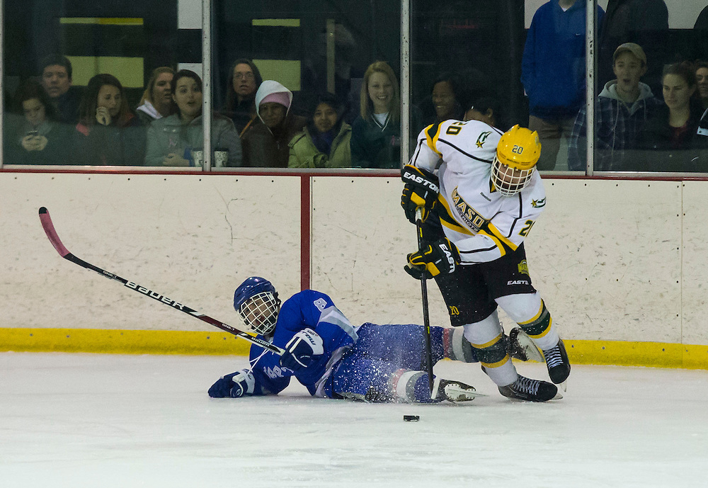 George Mason defenceman, Alex Mandeville, (R) takes control of the hockey puck against #8 ranked Christopher Newport defenceman, Chris Birkmeyer, (L) during the first period at Hampton Roads Iceplex in Newport News, VA on January 25, 2014.