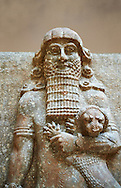 Stone statue of a Hero holding a lion. From facade M of the palace courtyard ,  Inv AO 19861 from Dur Sharrukin the palace of Assyrian king Sargon II at Khorsabad, 713-706 BC.  Louvre Museum Room 4 , Paris .<br /> <br /> If you prefer to buy from our ALAMY PHOTO LIBRARY  Collection visit : https://www.alamy.com/portfolio/paul-williams-funkystock/ancient-assyria-antiquities.html  Refine search by adding background colour, place, subject, museum etc into the LOWER SEARCH WITHIN GALLERY box to <br /> <br /> Visit our ANCIENT WORLD PHOTO COLLECTIONS for more photos to download or buy as wall art prints https://funkystock.photoshelter.com/gallery-collection/Ancient-World-Art-Antiquities-Historic-Sites-Pictures-Images-of/C00006u26yqSkDOM