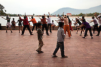 Exercise Along the Riverfront of the Kampot River is a regularly scheduled activity.  Each evening locals, neighbors and a few visitors join in for some aerobics in the cool of the day.