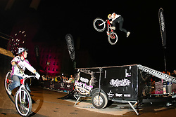 ©under licence to London News Pictures. 31 OCtober 2010, Trials cyclist Martyn Ashton (L) looks on as Scot Pilgrim perfroms a 360 tailwhip at the Relentless Freeze Festival 2010, Battersea Power Station, London. Held annually since 2008, Freeze features the world's best snowboarders and skiers  competing on a 32m high, 100m long, real snow ramp. 31 October 2010