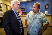 15 AUGUST 2012 - PHOENIX, AZ:   Senator JOHN MCCAIN (R-AZ) talks to a McCain supporter after a press conference Wednesday. Arizona's Republican US Senators, John McCain and Jon Kyl, announced their endorsement of Congressman Ben Quayle (R-AZ) during a press conference in Phoenix Wednesday. They decried the campaign being run by Quayle's opponent, Congressman David Schweikert (R-AZ). Both Quayle and Schweikert are freshman Congressmen from neighboring districts. They were thrown into the same district during the redistricting process and are now waging a bitter primary fight against each other.  PHOTO BY JACK KURTZ