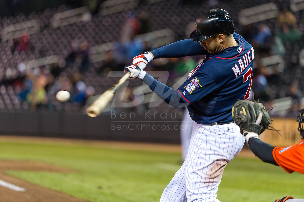 Joe Mauer #7 of the Minnesota Twins bats against the Miami Marlins in Game 2 of a split doubleheader on April 23, 2013 at Target Field in Minneapolis, Minnesota.  The Marlins defeated the Twins 8 to 5.  Photo: Ben Krause