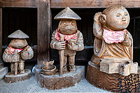 """Henro Figurines at Sekkeiji - Sekkeiji is Temple 33 on the Shikoku Pilgrimage and can be translated as, """"Snowy Cliff Temple"""". This temple is one of only three Zen temples on the Shikoku Pilgrimage. Legend has it that this place was home to a long-suffering ghost who woke up the monk, Geppou, saying """"Even the water is weary of living.""""  Geppou spoke to the apparition who was attempting to recall a poem from which these lines come. Once the poem was completed, the ghost disappeared having now been relieved of trying to recall the missing lines. In the 16th century it changed to a Rinzai Zen temple, now one of only three Zen temples on the pilgrimage."""