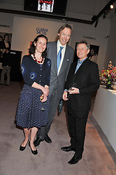 Left to right, The HON.JAMES STOURTON, ELEANOR NEWMAN and DAVID JENKINS at a party to celebrate the publication of Can We Still Be Friends by Alexandra Shulman held at Sotheby's, 34-35 New Bond street, London on 28th March 2012.