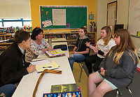 """Mayor Ed Engler and Whitney McCallum listen as Madelyn Young, Cali Andriski and Riley Clark-Patten bring ideas towards solving city problems posed by Mayor Engler during McCallum's """"genius hour"""" at Laconia Middle School on Wednesday afternoon.    (Karen Bobotas/for the Laconia Daily Sun)"""