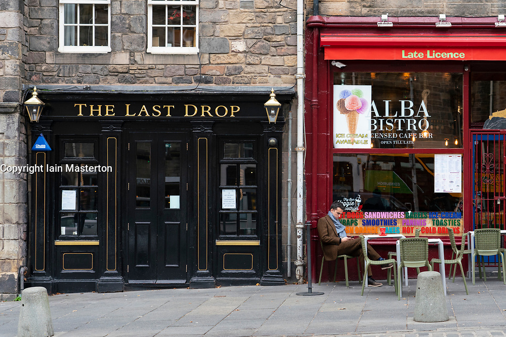 Edinburgh, Scotland, UK. 17 October 2020. Saturday afternoon in Edinburgh city centre during 16 day short circuit lockdown and bars are closed but cafes remain open. Streets in the Old town are very quiet and reminiscent of the eerie emptiness seen during the full lockdown earlier this year. On the Grassmarket The Last Drop bar is closed but Alba Bistro is open next door.   Iain Masterton/Alamy Live News