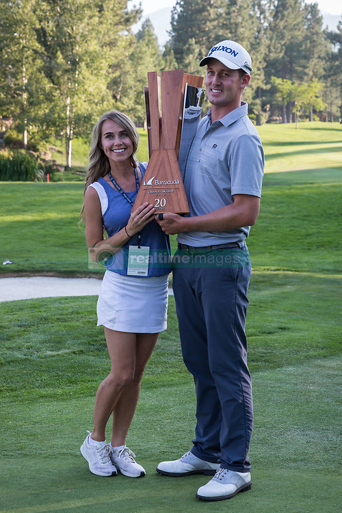 August 5, 2018 - Reno, Nevada, U.S - Sunday, August 5, 2018.Winner ANDREW PUTNAM, and his wife, TAWNY FRANS PUTNAM, pose for a photo with the tournament trophy after winning the 2018 Barracuda Championship at the Montreux Golf & Country Club. ..The Barracuda Championship Golf Tournament is one of only 47 stops on the PGA Tour worldwide, and has donated nearly $4 million to charity since 1999. Opened in 1997, the par-72 course was designed by Jack Nicklaus, plays at 7,472 yards (6,832 m) and its average elevation is 5,600 feet (1,710 m) above sea level...The Montrux Golf and Country Club is located midway between Reno and Lake Tahoe...As the tournament champion, Putnam, received a check in the amount of $612,000. (Credit Image: © Tracy Barbutes via ZUMA Wire)