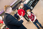Connolly Motor Group has opened its new state-of-the-art Audi Terminal Showrooms in Ballybrit, Galway. <br /> The finishing touches have been put to the ultra-modern dealership, increasing to 35 full-time jobs, bringing the number of full-time employees at the Connolly Motor Group to over  200 with 35 of those located in Galway.<br /> Work on the new €5 million state-of-the-art dealership began just before Christmas last year and opened on Tuesday October 31st.<br /> The new 'Audi Terminal' is just a stone's throw from Connollys' former Audi Galway dealership at the Briarhill Business Park, close to the Galway Racecourse in Ballybrit. <br /> Finished to the highest spec with the most up-to-date technology, the 23,000 sq. ft. car retail facility is based around Audi's newest design concept. <br /> It is one of the most modern facilities in the country and includes the most up-to-date technology for electric vehicles with multiple power points.<br /> At the Weekend launch was Audi Ambassador Joe Canning with Number 1 fan Cillian Maughan Athenry <br />  Photo:Andrew Downes