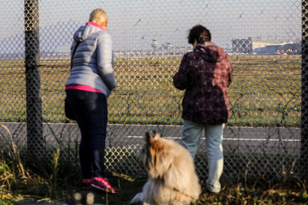 People gather on the fence at Tegel Airport (TXL) to witness the final departure made from the historic airport, Berlin, Germany, November 8, 2020. After more than 60 years Berlin's tiny northern airport is set to shut down all operations, with a final departure flight by AirFrance to Paris. (Photos by Omer Messinger)