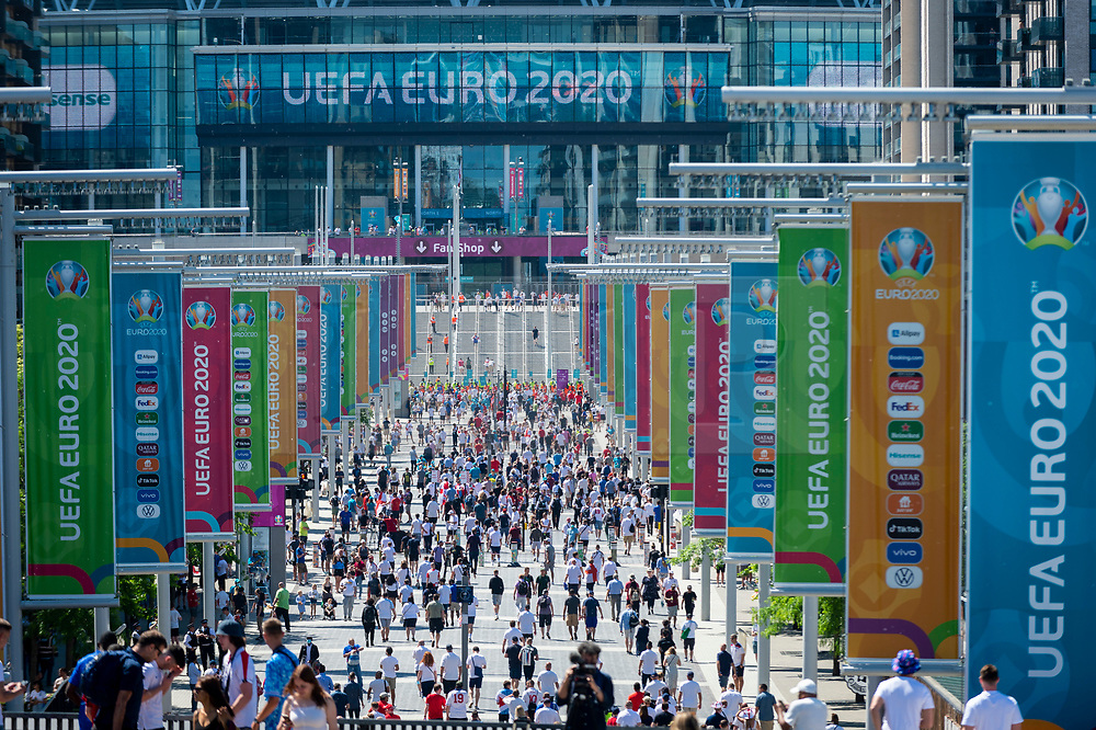 © Licensed to London News Pictures. 13/06/2021. LONDON, UK. Fans arrive for the England v Croatia match at Wembley Stadium for the 2020 UEFA European Football Championship, commonly known as Euro 2020. The tournament was postponed from 2020 due to the COVID-19 pandemic in Europe and rescheduled for 11 June to 11 July 2021 with matches to be played in 11 cities. Wembley Stadium will host certain group matches, as well as the semi-finals and final itself.  Photo credit: Stephen Chung/LNP