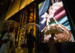 Night view of shop window of Louis Vuitton luxury boutique in Omotesando Tokyo