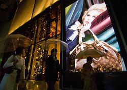 Night view of shop window of Louis Vuitton luxury boutique in Omotesando Tokyo