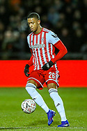 Brentford defender Ezri Konsa (26) on the ball during the The FA Cup fourth round match between Barnet and Brentford at The Hive Stadium, London, England on 28 January 2019.
