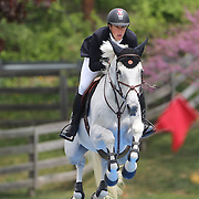 Ben Asselin riding Plume De La Roque in action during the $35,000 Grand Prix of North Salem presented by Karina Brez Jewelry during the Old Salem Farm Spring Horse Show, North Salem, New York, USA. 15th May 2015. Photo Tim Clayton