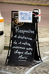 02 April 2020. Hesdin, Pas de Calais, France. <br /> Coronavirus - COVID-19 in Northern France.<br /> <br /> Easing restrictions on local markets. A sign on the pavement at the local street market reminding customers to keep a minimum of 1m apart. For the first time since government restrictions came into force, the main market in Hesdin has been permitted to re-open. The historical town has hosted a usually vibrant and bustling market since the middle ages. With stall holders limited and many suffering huge financial losses, those selling food today were happy to be back to work despite the ongoing risks posed by coronavirus.<br /> <br /> Shoppers, many wearing masks were mostly maintaining their social distancing with people happy to be out and able to meet and talk with other people. A lot of shoppers were elderly people who have been trapped in their homes for weeks. One shopper complained of 'la misère,' - the misery of this virus and being stuck in her home. <br /> <br /> Anyone leaving their home must carry with them an 'attestation,' in a effect a self administered permit to allow them out of the house. If stopped by the police, one must produce a valid permit along with identification papers. Failure to do so is punishable with heavy fines. Movement in France has been heavily restricted by the government and today's market re-opening was a brief return to normalcy for many able to escape the confines of their homes.<br /> <br /> Photo©; Charlie Varley/varleypix.com