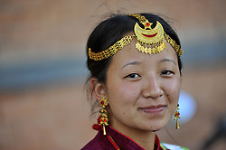 August 9, 2016 - Kathmandu, NE, Nepal - A Portrait of Yatri Yakkha, 23 yrs old, Nepalese Kirati girl in a traditional attire smiles as participate in the International Day of the 22nd World Indigenous Day celebrated in Kathmandu, Nepal, 09 August 2016. At the call of the United Nations, on August 9 every year the International Day of the World's Indigenous People observed by organizing different programs. (Credit Image: © Narayan Maharjan/NurPhoto via ZUMA Press)