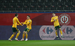LEUVEN, BELGIUM - Wednesday, March 24, 2021: Wales' Harry Wilson (R) celebrates after scoring the first goal with team-mates captain Gareth Bale (L) and Connor Roberts (C) during the FIFA World Cup Qatar 2022 European Qualifying Group E game between Belgium and Wales at the King Power Den dreef Stadium. Belgium won 3-1. (Pic by Vincent Van Doornick/Isosport/Propaganda)