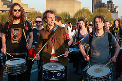 London, UK. 20th April 2019. The XR Samba Band performs on Waterloo bridge, which has been blocked by climate change campaigners from Extinction Rebellion for six days. During that time, they have created a Garden bridge used for International Rebellion activities to demand urgent action to combat climate change by the British government.