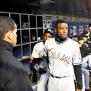 NEW YORK, NEW YORK - APRIL 11: Dee Gordon, Miami Marlins, in the dugout preparing to bat during the Miami Marlins Vs New York Mets MLB regular season ball game at Citi Field on April 11, 2016 in New York City. (Photo by Tim Clayton/Corbis via Getty Images)