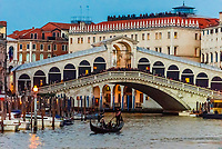Gondolas on the Grand Canal with Rialto Bridge in background, Venice, Italy.