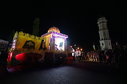 June 24, 2017 - Banda Aceh, Aceh, Indonesia - After the Isha prayer, the sound of takbir echoed from various parts of Banda Aceh City, Aceh Province, Indonesia. The community enliven laudation and the torch parade with an ornamental car. Parents and children are busy watching the parade which aims to welcome Idul Fitri 1438 H. Aceh is the only province in Indonesia that applies Islamic law. (Credit Image: © Abdul Hadi Firsawan/Pacific Press via ZUMA Wire)