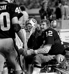 Raiders on bench..Ken Stabler and Fred Biletnikoff with Pete Banazak. (1971 photo/Ron Riesterer)