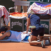 PARIS, FRANCE June 1.  Ashleigh Barty of Australia receives treatment courtside after the second set during her match against Bernarda Pera of the United States on Court Philippe-Chatrier during the first round of the singles competition at the 2021 French Open Tennis Tournament at Roland Garros on June 1st 2021 in Paris, France. (Photo by Tim Clayton/Corbis via Getty Images)