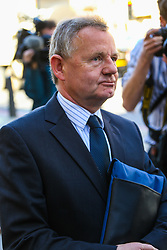 Andy Hill, 54, of Sandon, Hertfordshire, the pilot of the Hawker Hunter which crashed at the Shoreham Airshow in 2015 leaves Westminster Magistrates Court in London after indicating he will plead not guilty to killing 11 men when his aircraft hit the A27 in Sussex after performing an aerobatics display. London, April 19 2018.