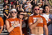 Members of the University of Texas team stand for the national anthem during the opening ceremonies for the 7th Annual Quidditch World Cup April 5, 2014 in Myrtle Beach, South Carolina. The sport, created from the Harry Potter novels is a co-ed contact sport with elements from rugby, basketball, and dodgeball. A quidditch team is made up of seven athletes who play with broomsticks between their legs at all times.