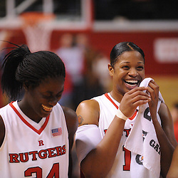 Feb 21, 2009; Piscataway, NJ, USA; Rutgers center Kia Vaughn (15) and Rutgers forward Chelsey Lee (34) celebrate their team's 55-42 victory over Providence at the Louis Brown Athletic Center.