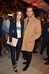 LUCY WATSON and JAMES DUNMORE at the launch of the new Ferrari 488 Spider held at Watches of Switzerland, 155 Regent Street, London on 25th February 2016.