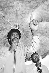 """Jay Naidoo, Minister without Portfolio, visited the Voice Educational Centre wehre a """"peoples' forum"""" on the RDP was held. The chairperson of the Orange Park Farm RDP, Mzwandile Khumalo is in the background. Pic: Chris Collingridge. 17/11/1994. Orange Park. © Times Media"""