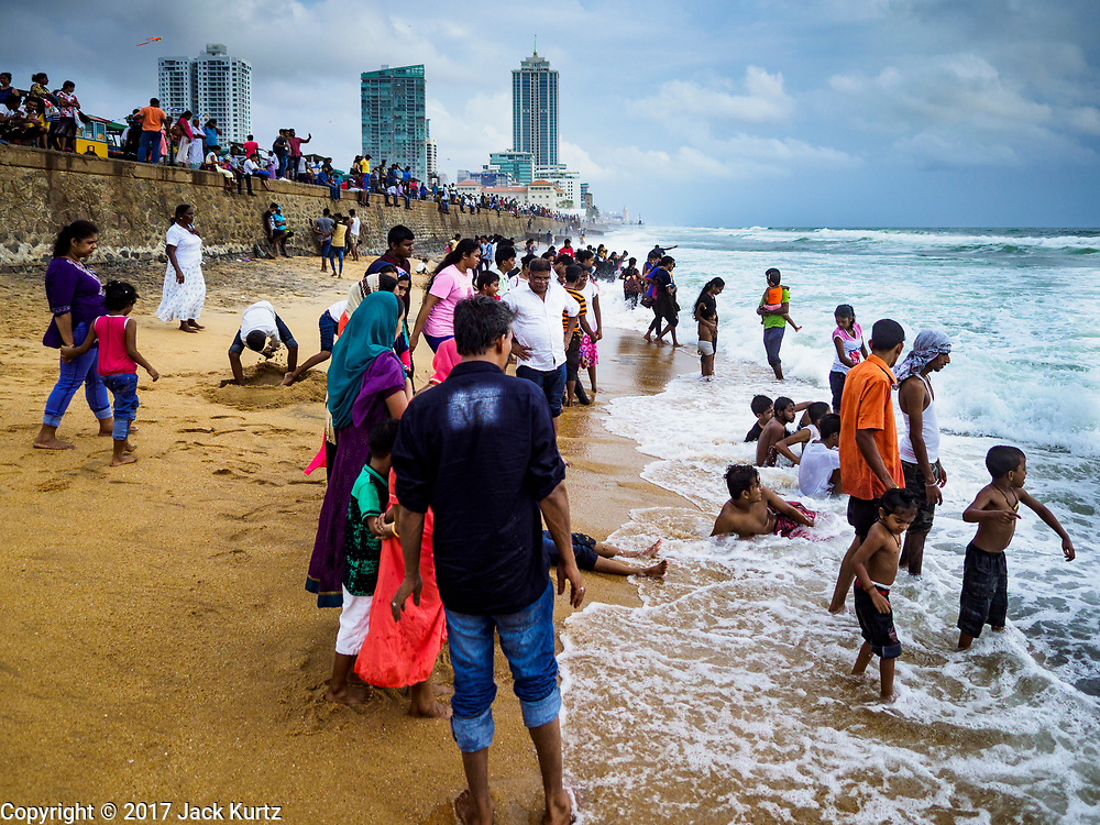 05 OCTOBER 2017 - COLOMBO, SRI LANKA: People play in the ocean along Galleface in Colombo, Sri Lanka.    PHOTO BY JACK KURTZ