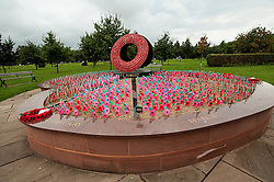 "© Licensed to London News Pictures. 17/10/2016. Alrewas  Staffordshire England  <br /> The Royal British Legion Never Forget Memorial ,The memorial features a giant wreath around which poppies, inscribed with individual names and dates, can be planted as a permanent tribute.""Never Forget"" is the shape of a poppy whose petals are flower beds for thousands of small wooden poppies to be planted, <br /> Rob Leyland/LNP"