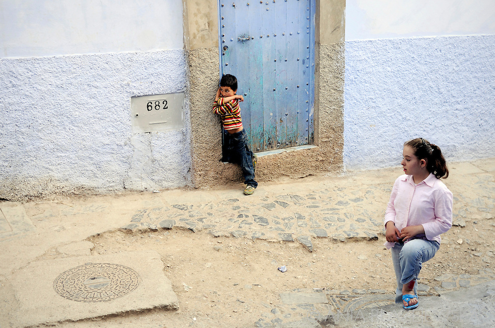 Morocco, Chefchaouen. Girls in the blue street.