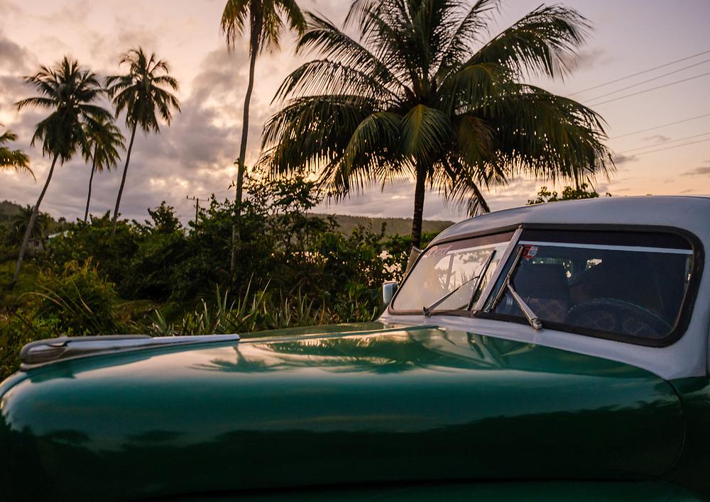 BARACOA, CUBA - CIRCA JANUARY 2020: Classic Cuban car around Bahia de Mata, a village close to Baracoa in Cuba.
