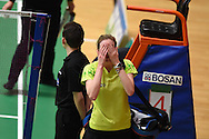 Carissa Turner of Wales reacts after she loses her Womens singles match against Linda Zetchiri .Wales international badminton championships 2014 at the Welsh institute of Sport, Sophia Gardens in Cardiff, South Wales on Friday 28th November 2014<br /> pic by Andrew Orchard, Andrew Orchard sports photography.
