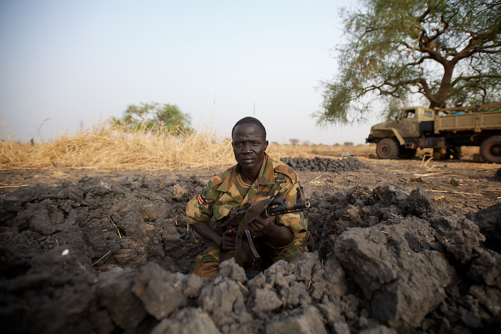 April 24, 2012 - Panakuach, South Sudan: A SPLA soldier takes position in a trench at the last defensive line outside the village of Panakuach, 70 kilometers north of Bentiu...South Sudan and their northern neighbors, Sudan, have in the past two weeks been involved in heavily clashes over border disputes. Bentiu and neighboring villages have been under constant bombardment by the troops os Karthoum , who established their positions around 10 kilometers into South Sudan's territory. The international community is concerned about the possibility of a full on war between the two countries. (Paulo Nunes dos Santos/Polaris)