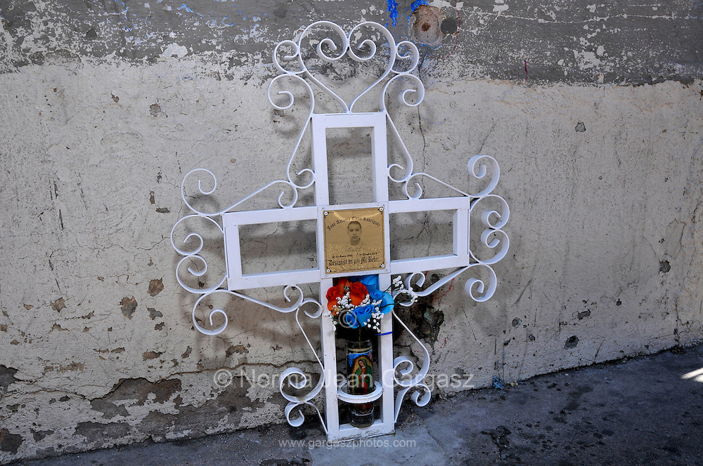 A cross along Calle Internacional in Nogales, Sonora, memorializes Mexican teenager, Jose Antonio Elena Rodriguez, 16, who was allegedly shot and killed by U.S. Border Patrol agents firing through the fence in to Mexico, where the youth was reported by a witness to be walking down the streetl on October 10, 2012.  The agents claim the the youth was throwing rocks at them either through or over the border fence in to Nogales, Arizona, USA.