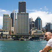 Man on passenger ferry as it arrives at Circular Quay, Sydney.