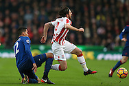 Chris Smalling of Manchester Utd fouls Joe Allen of Stoke city ®. .Premier league match, Stoke City v Manchester Utd at the Bet365 Stadium in Stoke on Trent, Staffs on Saturday 21st January 2017.<br /> pic by Andrew Orchard, Andrew Orchard sports photography.