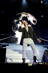 © Licensed to London News Pictures. 23/05/2012. London, UK. Westlife perform live at The O2 Arena, London, as part of their final ever farewell tour.   Westlife are an Irish boy band formed in 1998. They are to disband in 2012 after their farewell tour. The group's line-up was Shane Filan, Mark Feehily, Nicky Byrne, and Kian Egan.  In this picture - Nicky Byrne.  Westlife have sold over 45 million records worldwide which includes studio albums, singles, video release, and compilation albums.  Photo credit : Richard Isaac/LNP